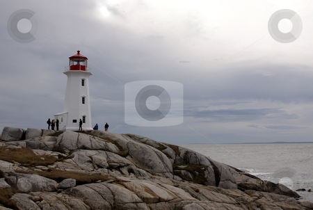 Peggy's Cove Tourists stock photo, The lighthouse at Peggy's Cove in Nova Scotia, Canada.  by Chris Hill