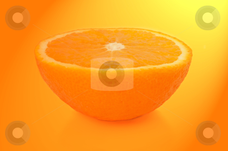 Orange half. stock photo, Close and low level capturing half an orange with yellow and orange light filter effect. by Samantha Craddock