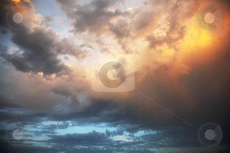 Colourful cloudy sky stock photo, The colourful cloudy sky on a sunset by krasyuk