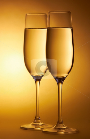 Two glasses of champagne stock photo, Two glasses of champagne on abstract yellow background by krasyuk