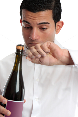 Closeup man opening wine stock photo, Closeup of a man or bartender holding and opening a bottle of wine or champagne.  White background. by Leah-Anne Thompson