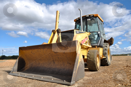 Backhoe Tractor Construction stock photo, Backhoe Tractor Construction by Brandon Bourdages