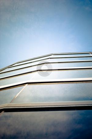Skyscraper stock photo, skyscraper windows are reflecting deep blue sky by Anatoliy Nykilchyk