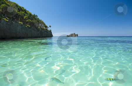 Turquoise caribbean waters stock photo, Beach and tropical sea in the caribbean by Christian Delbert