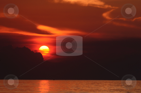 Sunrise stock photo, sun rising across the ocean in a tropical country by Arvind Balaraman