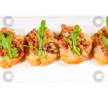 Italian bruschetta stock photo, fresh tipycal italian bruschetta with tomato and arugula on top by Francesco Perre