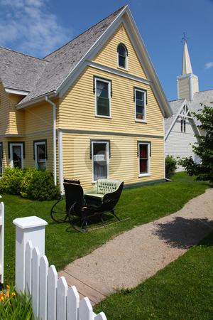 Beautiful old yellow house in summer  stock photo, Beautiful old yellow house in summer  by Melissa King