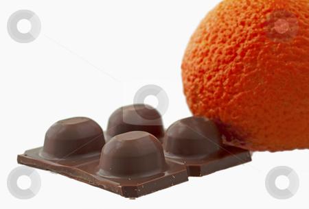 Chocolate stock photo, Piece of chocolate isolated over white background, with big orange by Fabio Alcini