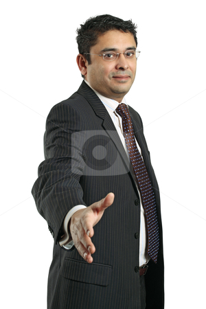Indian businessman handshake stock photo, An attractive Indian businessman in his late thirties extending his hand out. by © Ron Sumners