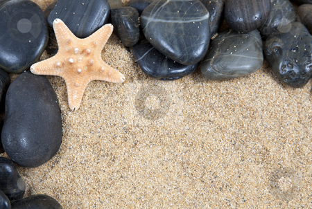 Zen spa river rocks and shells on sand in form of border stock photo, zen spa river rocks and shells on sand in form of border by Melissa King