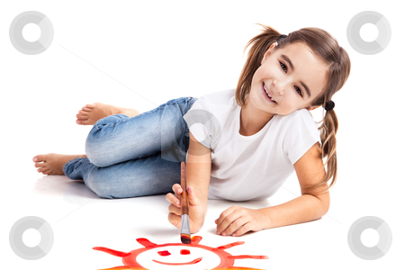 Painting a happy sun stock photo, Girl lying on floor and painting a happy sun by ikostudio