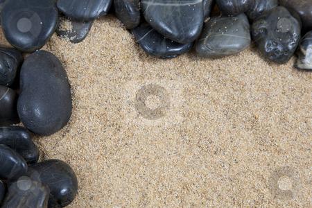 Zen spa river rocks on sand in form of border stock photo, zen spa river rocks on sand in form of border by Melissa King