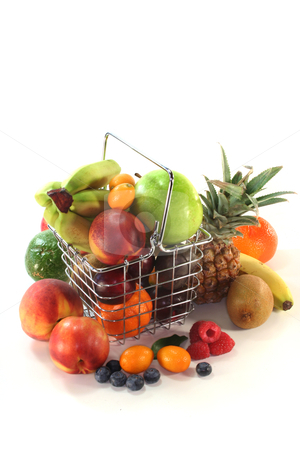 Fruit Mix in the Shopping basket stock photo, Mix of native and exotic fruits in a Shopping basket by Marén Wischnewski