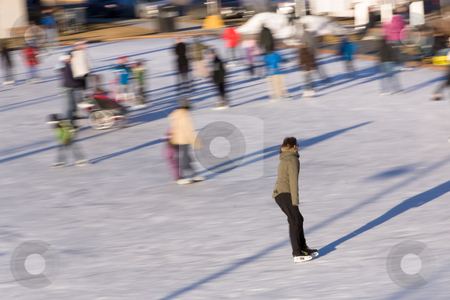 Girl on ice rink stock photo, girl skates on ice rink in sunny day by Anatoliy Nykilchyk