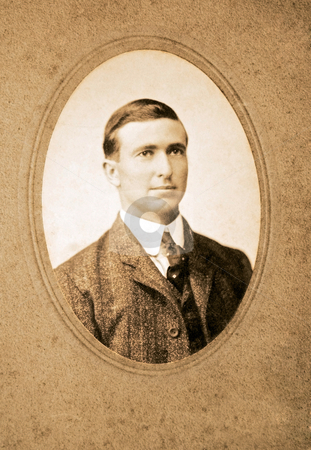 Vintage Photo of a Man stock photo, An original vintage photograph of a gentleman in coat and tie. by Susan Leggett