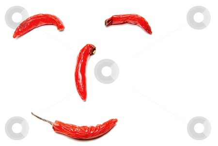 Hot Red Peppers stock photo, Hot Red Peppers making a smiley face. by Robert Byron