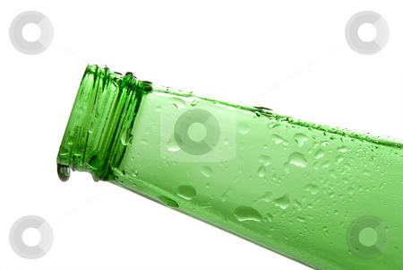 Beer Bottle stock photo, A drip on the end of a beer bottle by Robert Byron