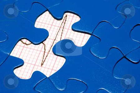 EKG stock photo, An EKG underneath a bright blue puzzle. by Robert Byron