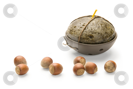 Hazelnuts and Candle, isolated on white background stock photo, Hazelnuts and Candle, isolated on white background by Andrey Zyk