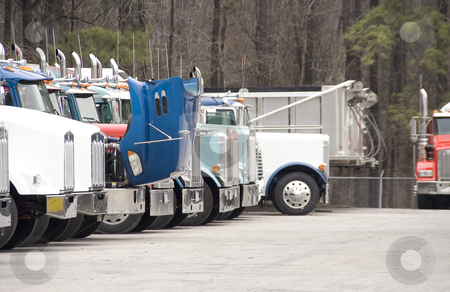 Tractor Trailor stock photo, A group of Tractor Trailor Trucks in a parking lot by Robert Byron
