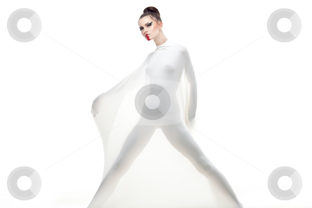 A conceptual studio shot of a young woman dressed in white. stock photo, a conceptual studio image of a young woman dressed in a white stretch fabric and wearing vanguardist makeup.  by dan comaniciu