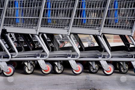 Shopping Carts stock photo, A long line of retail shopping carts by Robert Byron