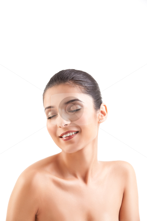 A beauty image of a young woman with her eyes shut, smiling. stock photo, a studio beauty shot of a beautiful woman, with naked shoulders, on white background. her head is turned to the side, her eyes are shut and she is smiling. by dan comaniciu