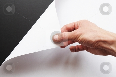 Hand turning paper stock photo, hand turning over blank sheet of paper by Gunnar Pippel