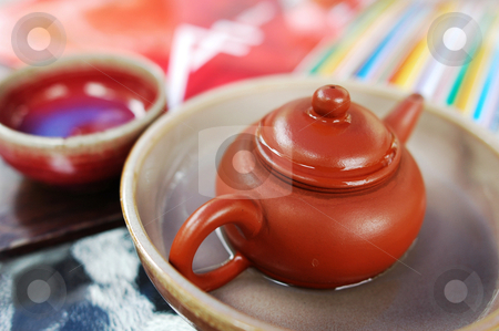 Teaset stock photo, Closeup view of a pottery teapot with teacup  by John Young