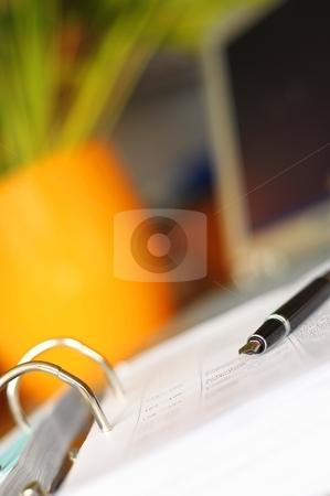 Desktop in office stock photo, business desktop still life with folder pen copyspace and laptop in office by Gunnar Pippel