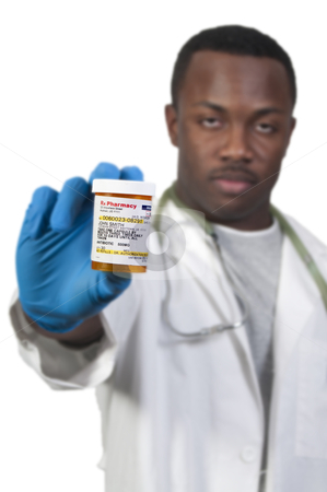 High Cost of Healthcare stock photo, prescription medication pill bottle being held by a blurred Black man African American doctor by Robert Byron