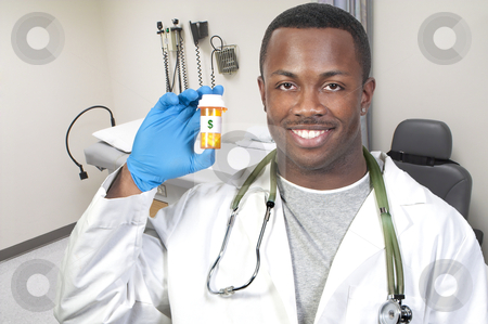 High Cost of Healthcare stock photo, Black man African American holding a prescription medication pill bottle by Robert Byron