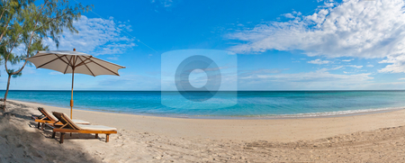 Deckchairs on the beach stock photo, Panorama deckchair and parasol on the white sand beach facing the lagoon by Pierre-Yves Babelon