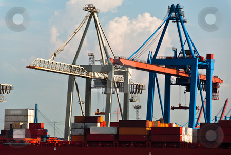 Container Terminal in Hamburg Harbor, Germany stock photo, Container ship being unloaded using massive cranes in Hamburg Dock, Germany. Hamburg is the second biggest container port in Europe and can serve the largest ships. by Frank G?