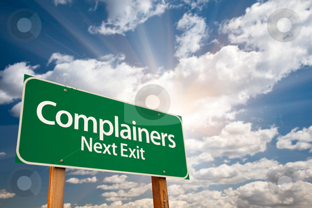 Complainers Green Road Sign and Clouds stock photo, Complainers Green Road Sign with Dramatic Clouds, Sun Rays and Sky. by Andy Dean
