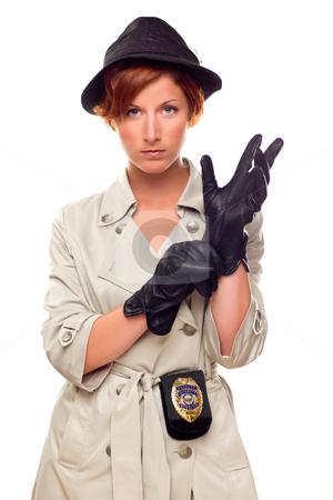 Red Haired Female Detective Putting on Gloves Wearing a Trenchco stock photo, Red Haired Female Detective Putting on Gloves Wearing a Badge, Trenchcoat and Hat Isolated on a White Background. by Andy Dean
