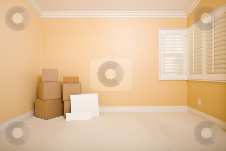Moving Boxes and Blank Signs on Floor in Empty Room  stock photo, Moving Boxes and Blank Signs on Floor in Empty Room with Copy Space on Blank Wall. by Andy Dean