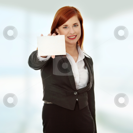 Business woman holding a blank card stock photo, Beautiful smiling business woman holding a blank card - focus on card by Piotr_Marcinski