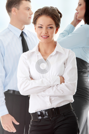 Businesswoman stock photo, Businesswoman against two other businesspeople by Piotr_Marcinski