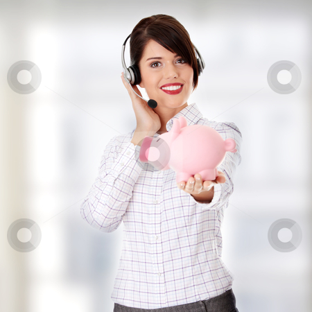 Young business woman stock photo, Young business woman with headset holding piggy bank  by Piotr_Marcinski