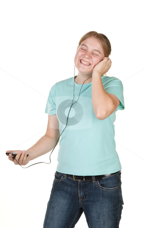 Teenager singing and dancing stock photo, teenage girl singing and dancing to music on mp3 by Phil Morley