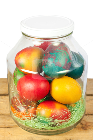 Easter jar eggs stock photo, Easter concept.Colorful easter eggs in a jar by borojoint