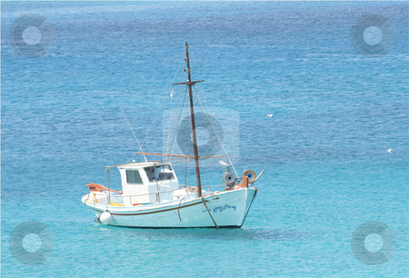 Boat from greece stock photo, a boat over crystral clear blue water from greece island by Stelian Ion