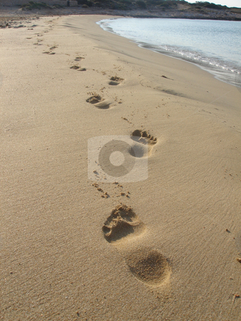 Beautiful footprints stock photo, beautiful footprints on golden sand of greece  islands                       by Stelian Ion