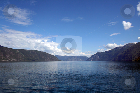 Norwegian fjords stock photo, beautiful norwegian fjords with a clear blue sky by Stelian Ion
