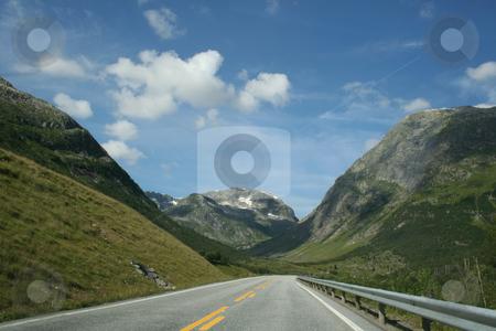 Norwegian mountains stock photo, a road throw the beautiful norwegian mountains by Stelian Ion