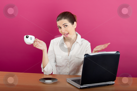 Businesswoman stock photo, Businesswoman sitting in the office drinking a coffee by ikostudio