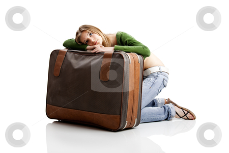 Tired woman stock photo, Beautiful young woman with old leather suitcases by ikostudio