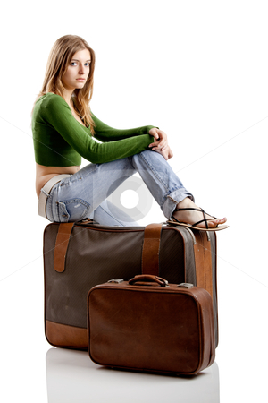 Travel woman stock photo, Beautiful young woman seated and waiting with two old leather suitcases by ikostudio