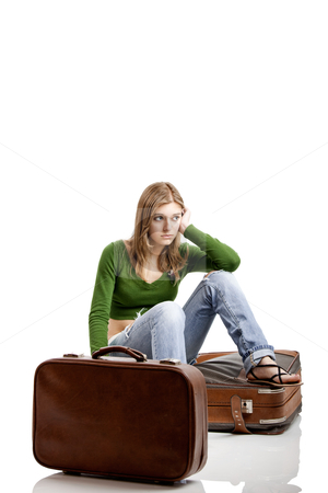Travel woman stock photo, Beautiful young woman seated amd waiting with two old leather suitcases by ikostudio